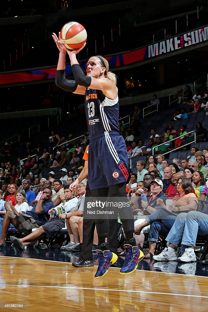 Katie Douglas of the Connecticut Sun shoots against the Washington Mystics at the Verizon Center on June 27 2014 in Washington DC NOTE TO USER User...