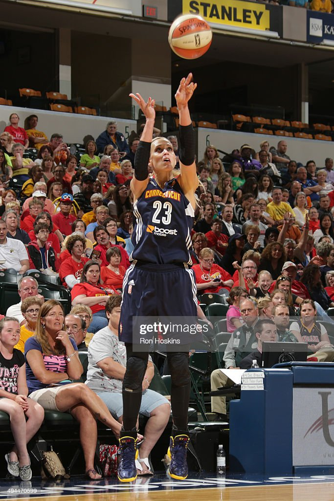 Katie Douglas of the Connecticut Sun takes a shot against the Indiana Fever on May 29 2014 at Bankers Life Fieldhouse Indianapolis IN NOTE TO USER...