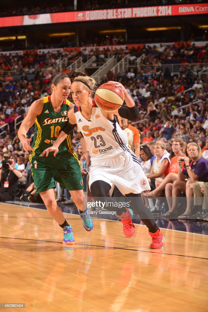 Katie Douglas of the Eastern Conference AllStars dribbles against Sue Bird of the Western Conference AllStars during the 2014 Boost Mobile WNBA...