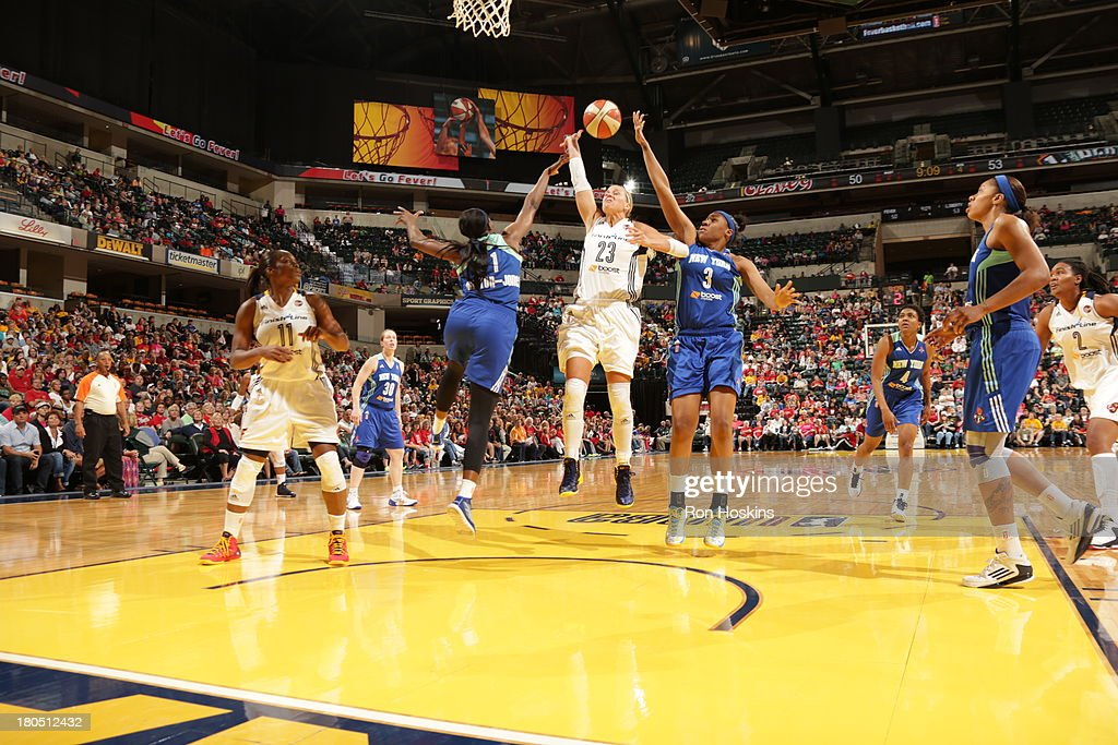 Katie Douglas of the Indiana Fever battles DeLisha MiltonJones and Kelsey Bone of the New York Liberty on September 10 2013 at Bankers Life...