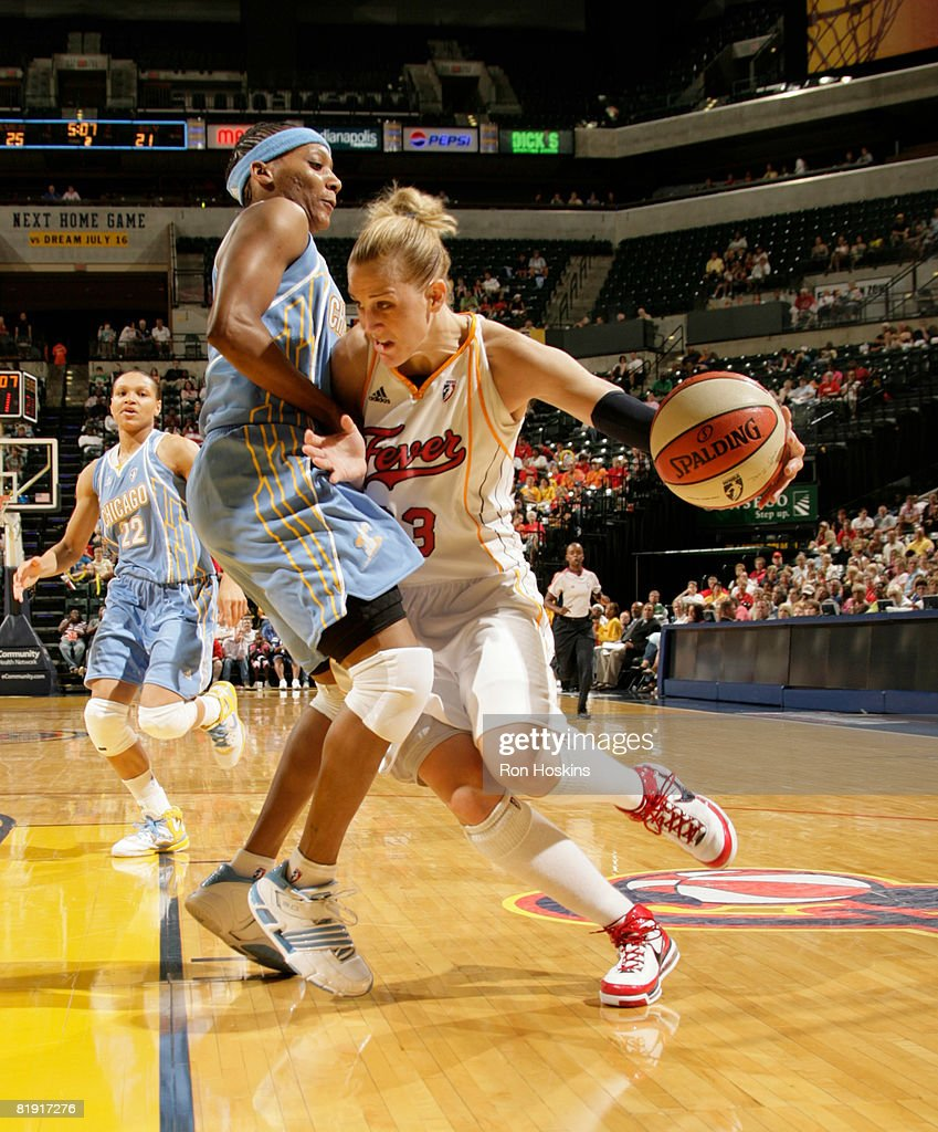 Katie Douglas of the Indiana Fever drives on Dominique Chanty of the Chicago Sky at Conseco Fieldhouse on July 12 2008 in Indianapolis Indiana NOTE...