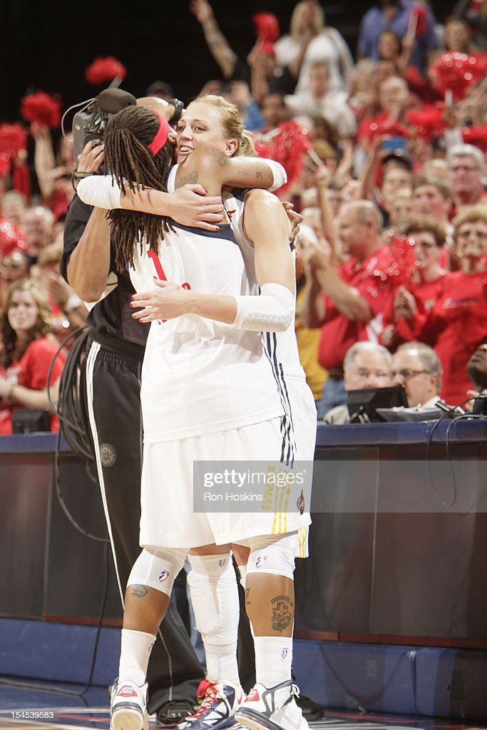 Katie Douglas #23 of the Indiana Fever hugs Shavonte Zellous #1 against the Minnesota Lynx during Game four of the 2012 WNBA Finals on October 21, 2012 at Bankers Life Fieldhouse in Indianapolis, Indiana.