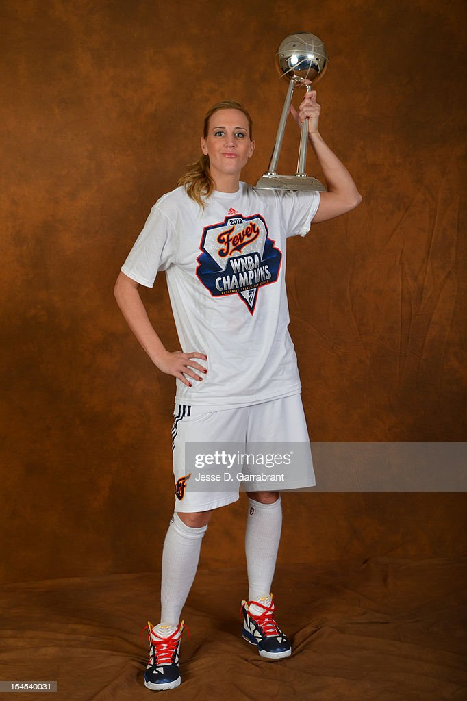 Katie Douglas #23 of the Indiana Fever poses for portraits with the Championship Trophy after Game four of the 2012 WNBA Finals on October 21, 2012 at Bankers Life Fieldhouse in Indianapolis, Indiana.