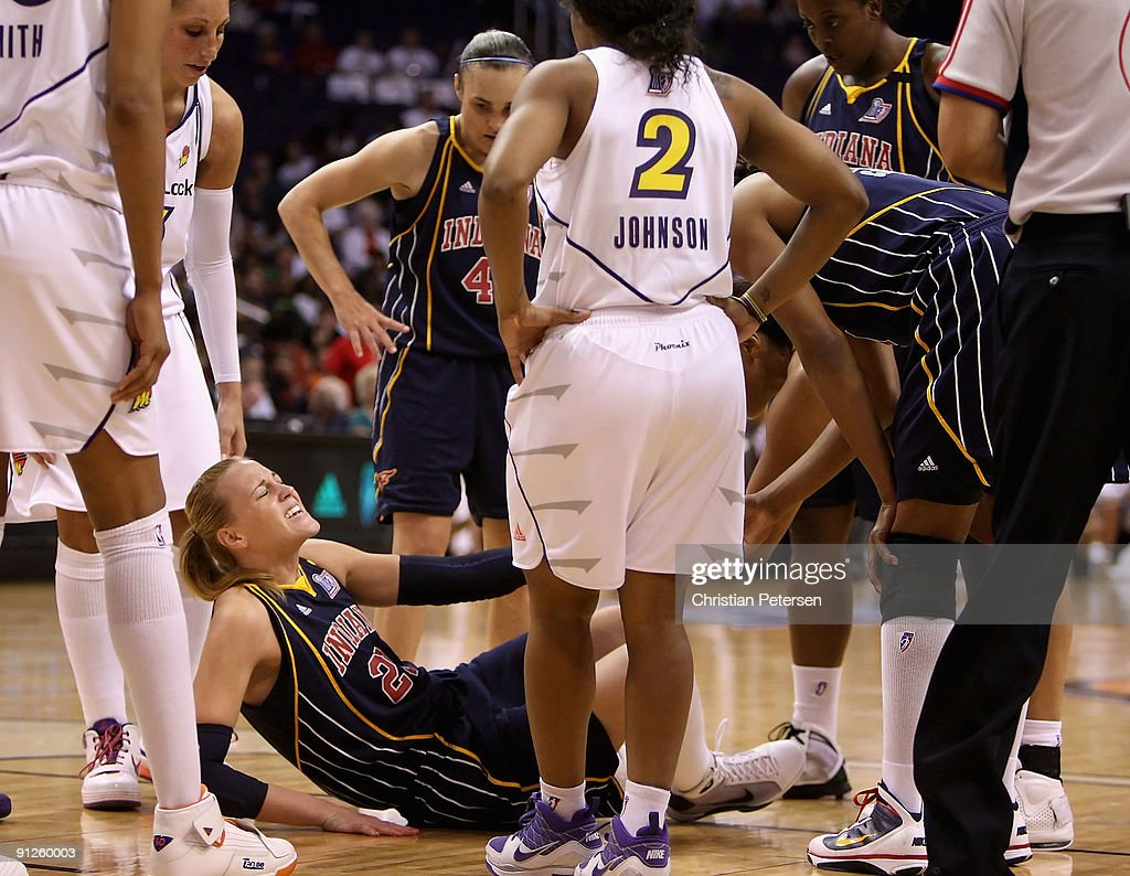 <a gi-track='captionPersonalityLinkClicked' href=/galleries/search?phrase=Katie+Douglas&family=editorial&specificpeople=213099 ng-click='$event.stopPropagation()'>Katie Douglas</a> #23 of the Indiana Fever reacts after hurting her ankle in Game One of the 2009 WNBA Finals against the Phoenix Mercury at US Airways Center on August 29, 2009 in Phoenix, Arizona. The Mercury defeated the Fever 120-116 in overtime to take a 1-0 series lead.