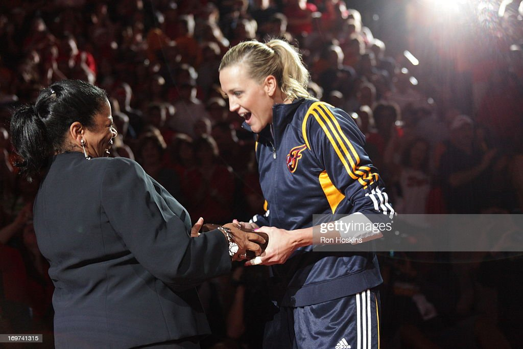 <a gi-track='captionPersonalityLinkClicked' href=/galleries/search?phrase=Katie+Douglas&family=editorial&specificpeople=213099 ng-click='$event.stopPropagation()'>Katie Douglas</a> #23 of the Indiana Fever reacts as she receives her 2012 WNBA Championship ring from WNBA Commissioner Laurel Richie on May 31, 2013 at Bankers Life Fieldhouse in Indianapolis, Indiana.