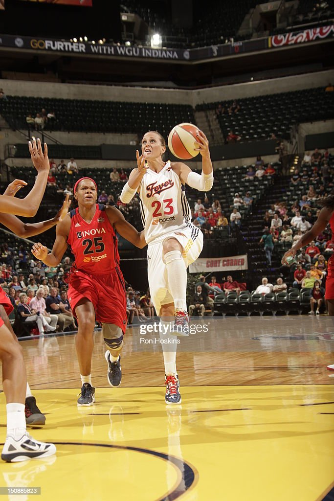 Katie Douglas of the Indiana Fever scores over Monique Currie of the Washington Mystics at Banker Life Fieldhouse on August 28 2012 in Indianapolis...
