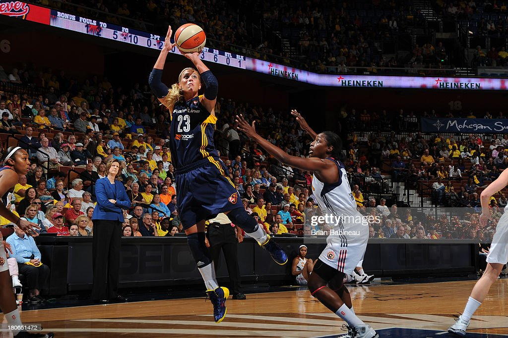 Katie Douglas of the Indiana Fever shoots against Kalana Greene of the Connecticut Sun on September 15 2013 at the Mohegan Sun in Uncasville...