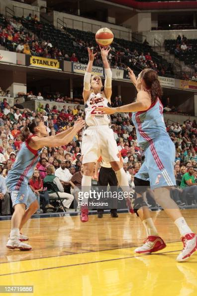 Katie Douglas of the Indiana Fever shoots over Alison Bales and Coco Miller of the Atlanta Dream at Conseco Fieldhouse on September 11 2011 in...
