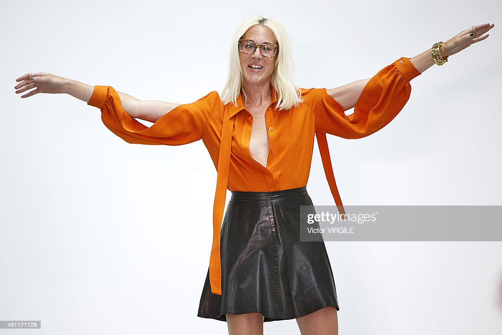 Katie Eary walks the runway at the Katie Eary show during the London Collections Men SS15 at Victoria House on June 17 2014 in London England