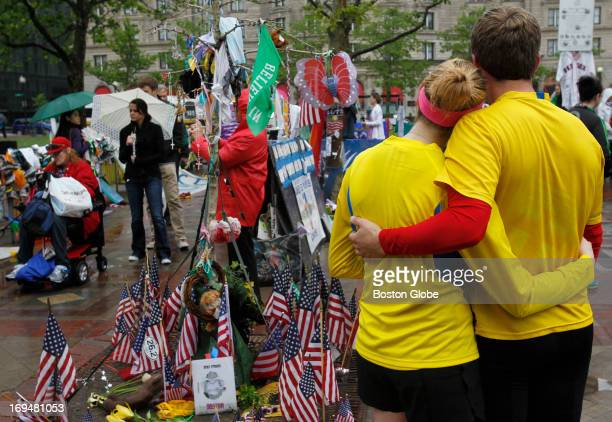Katie Eastman of Boston stands with Ciaran Shaughnessy of Chicago at the marathon bombing memorial in Copley Square after the two ran the Boston...