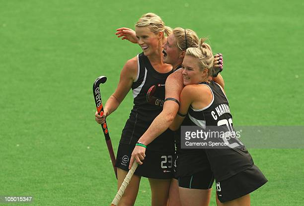 Katie Glynn of New Zealand is congratulated by team mates Anna Thorpe and Charlotte Harrison after scoring a goal during the women's pool B match...