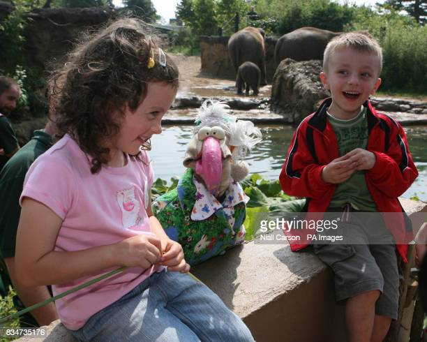 Katie Halpin 6 and Sam Noctor from Dublin are surprised by Ireland's Eurovision hopeful Dustin the Turkey at Dublin Zoo after they were winners in...