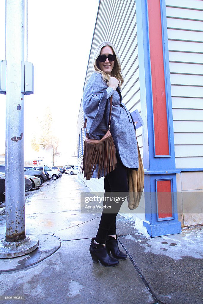 Katie Hammond owner of Cake Boutique from Park City, Utah, wearing Hatch Collection coat, Vince pants, Rag & Bone boots, Alexander McQueen sunglasses, and Cyndy Vincent bags on January 17, 2013 on the streets of Park City, Utah.