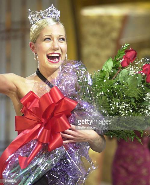 Katie Harman carries a giant bouquet of roses after winning the Miss America 2002 crown September 22 2001 in Atlantic City NJ