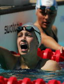 Katie Hoff of the United States gasps for breath after competing in the women's swimming 400 metre individual medley heat on August 14 2004 during...
