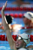Katie Hoff waves to the crowd after winning the 200 meter Individual Medley final during the US Swimming Olympic Team Trials on July 10 2004 at the...