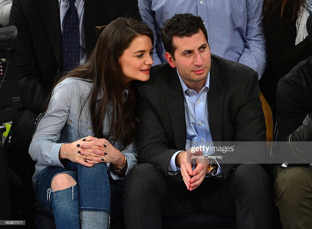 Katie Holmes and guest attend the Golden State Warriors vs New York Knicks game at Madison Square Garden on February 27, 2013 in New York City.