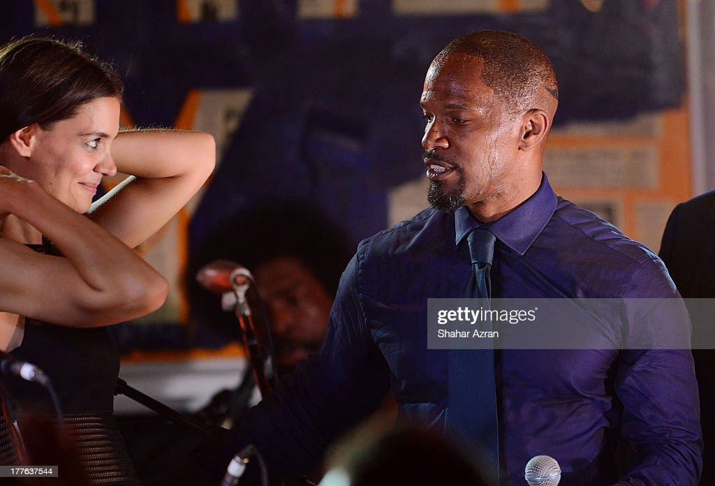 katie Holmes and <a gi-track='captionPersonalityLinkClicked' href=/galleries/search?phrase=Jamie+Foxx&family=editorial&specificpeople=201715 ng-click='$event.stopPropagation()'>Jamie Foxx</a> perform at the 4th Annual Apollo In The Hamptons Benefit on August 24, 2013 in East Hampton, New York.