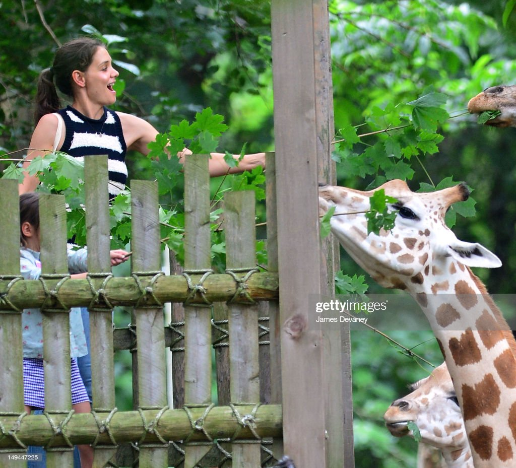 Katie Holmes and Suri Cruise feed giraffes at the Bronx Zoo on July 28, 2012 in New York City.