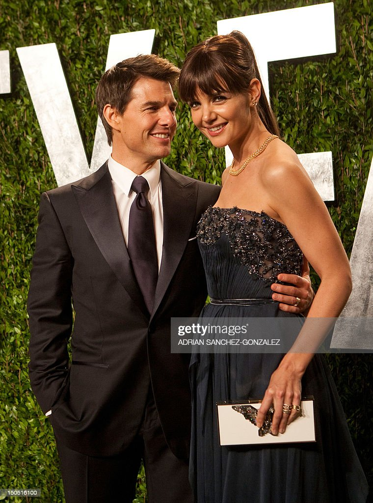 Katie Holmes and Tom Cruise (L) arrive at the Vanity Fair Oscar Party for the 84th Annual Academy Awards at the Sunset Tower on February 26, 2012 in West Hollywood, California.