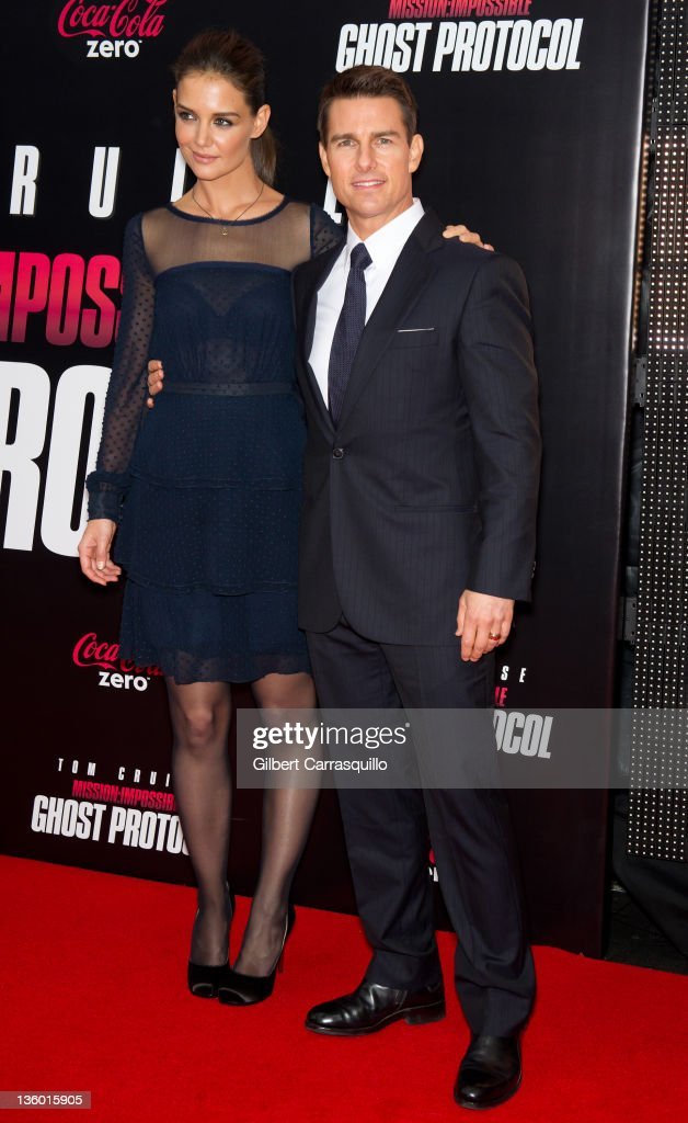 <a gi-track='captionPersonalityLinkClicked' href=/galleries/search?phrase=Katie+Holmes&family=editorial&specificpeople=201598 ng-click='$event.stopPropagation()'>Katie Holmes</a> and <a gi-track='captionPersonalityLinkClicked' href=/galleries/search?phrase=Tom+Cruise&family=editorial&specificpeople=156405 ng-click='$event.stopPropagation()'>Tom Cruise</a> attend the 'Mission: Impossible - Ghost Protocol' U.S. premiere at the Ziegfeld Theatre on December 19, 2011 in New York City.