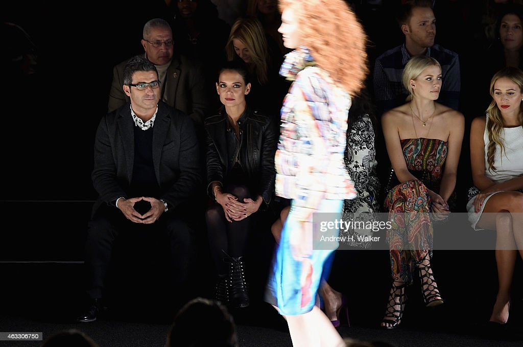 Katie Holmes (2L) attends the Desigual show during Mercedes-Benz Fashion Week Fall 2015 at Lincoln Center for the Performing Arts on February 12, 2015 in New York City.