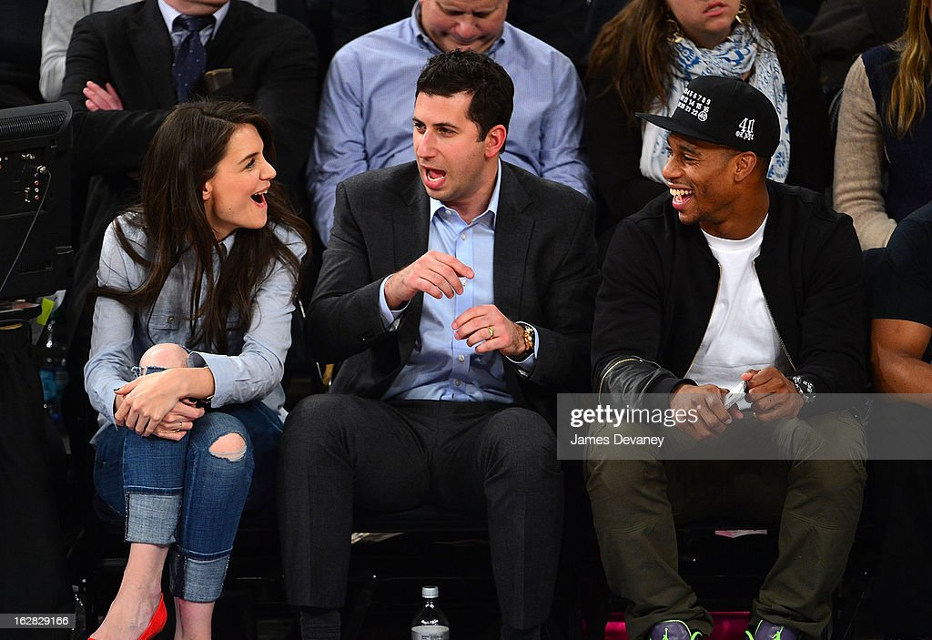 Katie Holmes, guest and Victor Cruz attend the Golden State Warriors vs New York Knicks game at Madison Square Garden on February 27, 2013 in New York City.