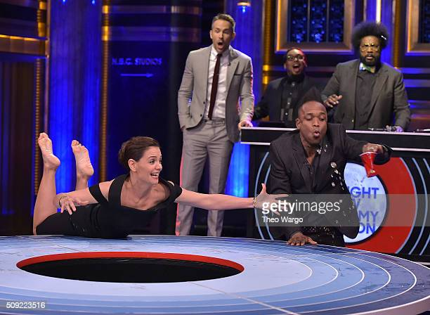 Katie Holmes Kirk Douglas of The Roots Ryan Reynolds and Questlove play a game of 'Musical Beers' during a taping of 'The Tonight Show Starring Jimmy...