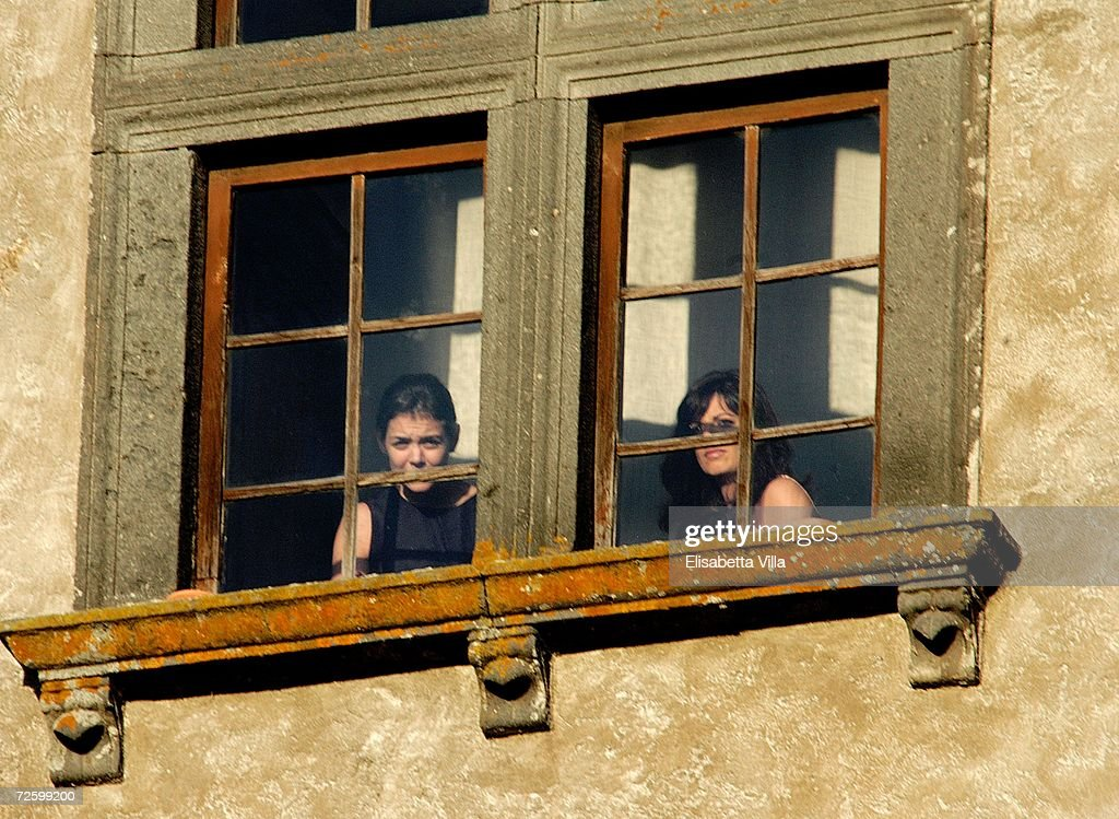 Katie Holmes (L) looks out from a window prior to her marriage to Tom Cruise at Castello Odescalchi on November 18, 2006 in Bracciano near Rome, Italy.