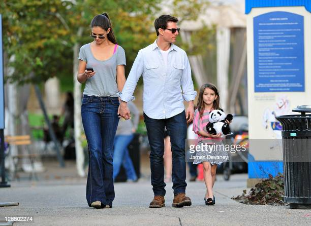 Katie Holmes Tom Cruise and Suri Cruise visit Schenley Plaza's carousel on October 8 2011 in Pittsburgh Pennsylvania