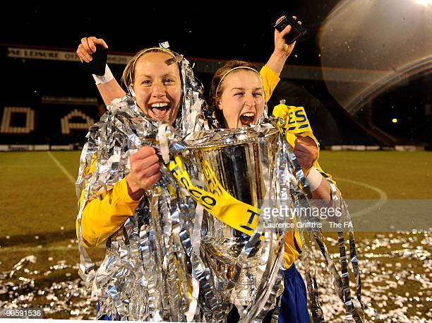 Katie Holtham and Ellen White of Leeds celebrate with the trophy during the Tesco Womens Premier League Cup Final between Everton and Leeds Carnegie...