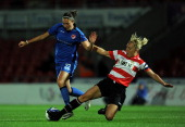 Katie Holtham of Doncaster Rovers Belles Ladies FC tackles Jodie Taylor of Lincoln Ladies FC during the FA Women's Super League match between...