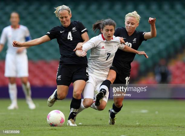 Katie Hoyle of New Zealand and Betsy Hassett of New Zealand challenge Karen Carney of Great Britain during the Women's Football first round Group E...