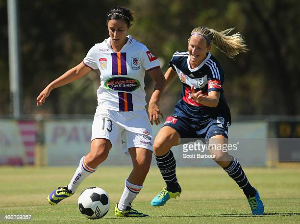 Katie Hoyle of the Victory and Elisa D'Ovidio of the Glory compete for the ball during the round 11 WLeague match between Melbourne Victory and Perth...