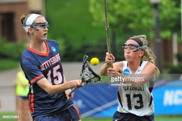 Katie Landry of Gettysburg College and Jaclyn Douglas of College of New Jersey fight for a loose ball during the Division III Women's Lacrosse...