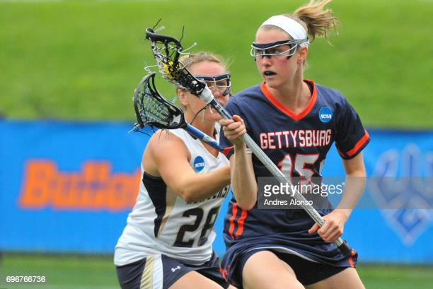 Katie Landry of Gettysburg College pushes the ball upfield against Ellie O'Neill of the College of New Jersey during the Division III Women's...