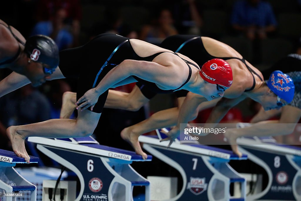 <a gi-track='captionPersonalityLinkClicked' href=/galleries/search?phrase=Katie+Ledecky&family=editorial&specificpeople=9595921 ng-click='$event.stopPropagation()'>Katie Ledecky</a> and <a gi-track='captionPersonalityLinkClicked' href=/galleries/search?phrase=Amanda+Weir&family=editorial&specificpeople=698123 ng-click='$event.stopPropagation()'>Amanda Weir</a> of the United States dive in to compete in a heat for the Women's 100 Meter Freestyle during Day Five of the 2016 U.S. Olympic Team Swimming Trials at CenturyLink Center on June 30, 2016 in Omaha, Nebraska.