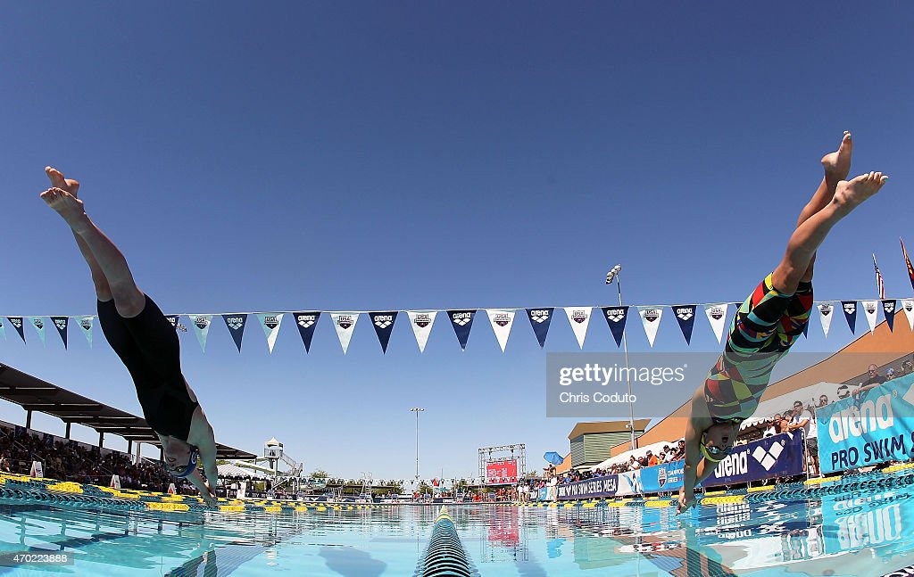 <a gi-track='captionPersonalityLinkClicked' href=/galleries/search?phrase=Katie+Ledecky&family=editorial&specificpeople=9595921 ng-click='$event.stopPropagation()'>Katie Ledecky</a> (L) and <a gi-track='captionPersonalityLinkClicked' href=/galleries/search?phrase=Katie+McLaughlin+-+Swimmer&family=editorial&specificpeople=14941254 ng-click='$event.stopPropagation()'>Katie McLaughlin</a> (R) launch off the blocks in the 100m Freestyle Prelims during day four of the Arena Pro Swim Series at the Skyline Aquatic Center on April 18, 2015 in Mesa, Arizona.