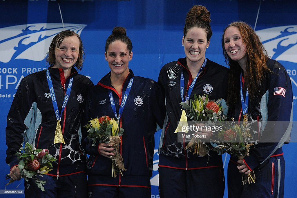 <a gi-track='captionPersonalityLinkClicked' href=/galleries/search?phrase=Katie+Ledecky&family=editorial&specificpeople=9595921 ng-click='$event.stopPropagation()'>Katie Ledecky</a> and <a gi-track='captionPersonalityLinkClicked' href=/galleries/search?phrase=Leah+Smith+-+Swimmer&family=editorial&specificpeople=16040607 ng-click='$event.stopPropagation()'>Leah Smith</a>, <a gi-track='captionPersonalityLinkClicked' href=/galleries/search?phrase=Missy+Franklin+-+Swimmer&family=editorial&specificpeople=6623958 ng-click='$event.stopPropagation()'>Missy Franklin</a> and <a gi-track='captionPersonalityLinkClicked' href=/galleries/search?phrase=Shannon+Vreeland&family=editorial&specificpeople=6738252 ng-click='$event.stopPropagation()'>Shannon Vreeland</a> of the United States celebrate on the podium after winning the Women's 4 x 200m Freestyle Relay Final during day two of the 2014 Pan Pacific Championships at Gold Coast Aquatics on August 22, 2014 on the Gold Coast, Australia.