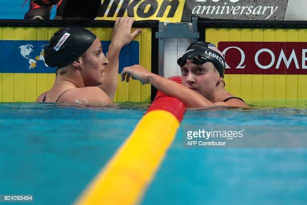 US Katie Ledecky and US Leah Smith react after competing in the women's 800m freestyle final during the swimming competition at the 2017 FINA World...
