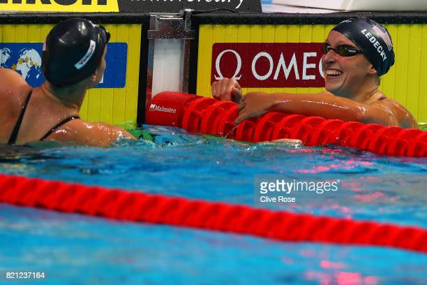 Katie Ledecky of the United States celebrates winning gold with Silver medel winner Leah Smith of the United States during the Women's 400m Freestyle...
