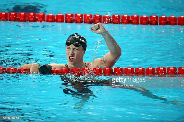 Katie Ledecky of the United States celebrates winning the gold medal in a new world record of 152548 in the Women's 1500m Freestyle Final on day...