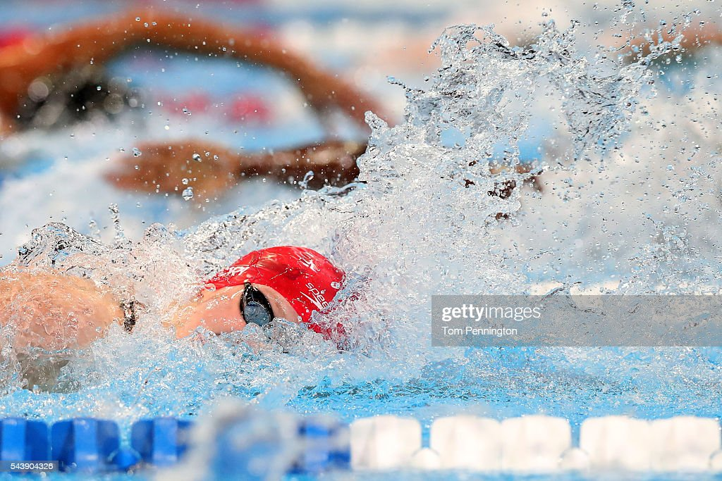 <a gi-track='captionPersonalityLinkClicked' href=/galleries/search?phrase=Katie+Ledecky&family=editorial&specificpeople=9595921 ng-click='$event.stopPropagation()'>Katie Ledecky</a> of the United States competes in a heat for the Women's 100 Meter Freestyle during Day Five of the 2016 U.S. Olympic Team Swimming Trials at CenturyLink Center on June 30, 2016 in Omaha, Nebraska.