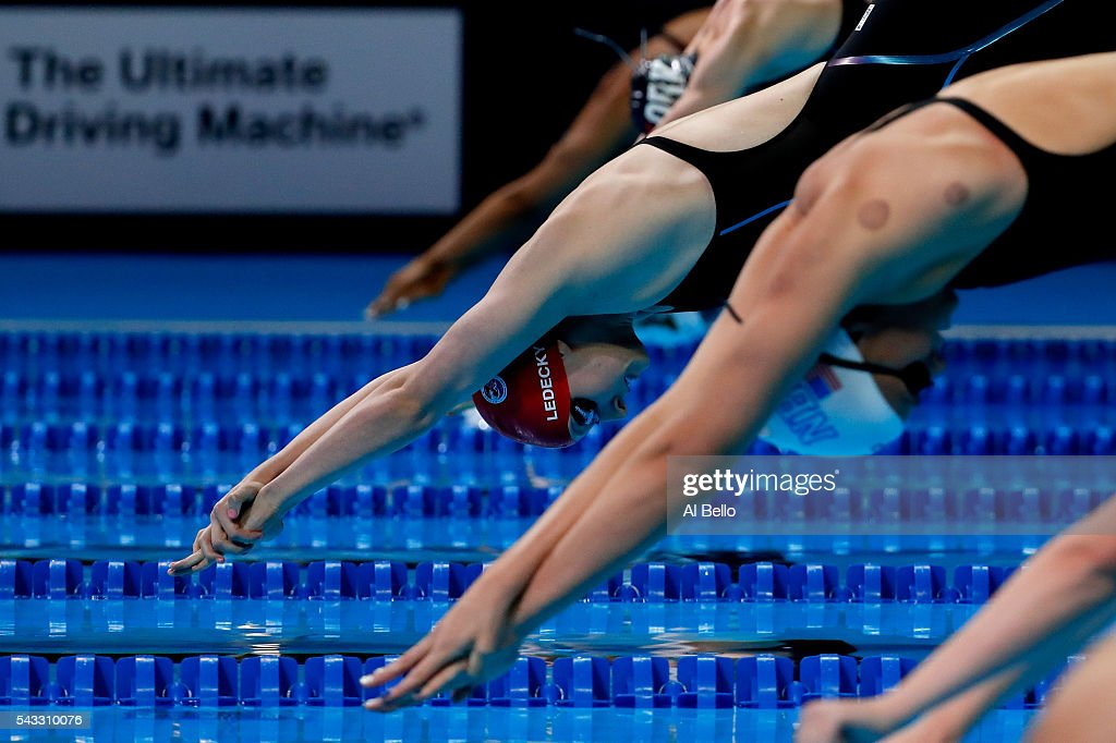 <a gi-track='captionPersonalityLinkClicked' href=/galleries/search?phrase=Katie+Ledecky&family=editorial&specificpeople=9595921 ng-click='$event.stopPropagation()'>Katie Ledecky</a> of the United States dives in to compete in a heat for the Women's 400 Meter Freestyle during Day Two of the 2016 U.S. Olympic Team Swimming Trials at CenturyLink Center on June 27, 2016 in Omaha, Nebraska.