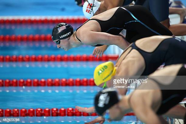 Katie Ledecky of the United States dives in to compete to win the gold medal in a new world record of 152548 in the Women's 1500m Freestyle Final on...