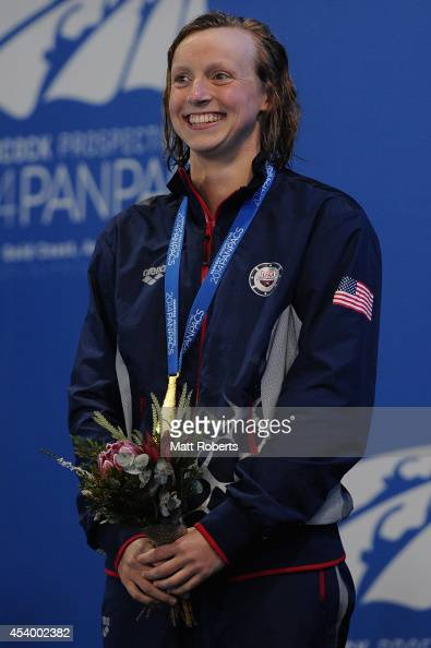 Katie Ledecky of the United States smiles on the podium after winning the Women's 400m Freestyle Final during day three of the 2014 Pan Pacific...