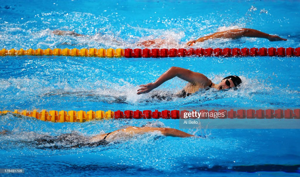 <a gi-track='captionPersonalityLinkClicked' href=/galleries/search?phrase=Katie+Ledecky&family=editorial&specificpeople=9595921 ng-click='$event.stopPropagation()'>Katie Ledecky</a> of the USA (C) sets a new World Record time of 8:13.86 in the Swimming Women's Freestyle 800m Final on day fifteen of the 15th FINA World Championships at Palau Sant Jordi on August 3, 2013 in Barcelona, Spain.