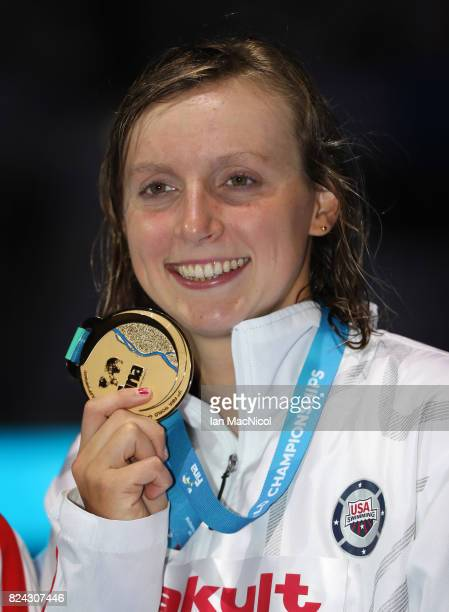 Katie Ledecky of United States poses with her gold medal from the women's 800m final during the FINA World Championships at the Duna Arena on day...