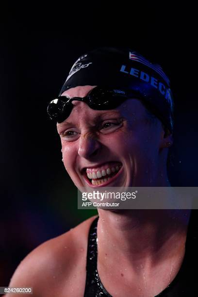 US Katie Ledecky reacts after competing in the women's 800m freestyle final during the swimming competition at the 2017 FINA World Championships in...