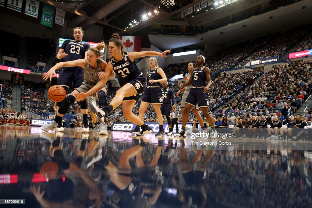 Katie Lou Samuelson #33 of the Connecticut Huskies and Kathryn Westbeld #33 of the Notre Dame Fighting Irish challenge for a loose ball during the the UConn Huskies Vs Notre Dame, NCAA Women's Basketball game at the XL Center, Hartford, Connecticut. December 3, 2017